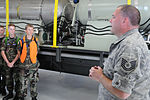 Technical Sgt. Mike Lamantia explains the C-130 Modular Aerial Spay System (MASS) to a group of Ohio Civil Air Patrol.JPG