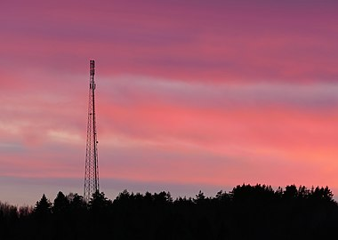Telecommunications mast in red sunset.jpg