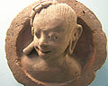 Terracota lady bust (peeping).jpg