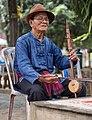 Thai Lue musician at Wat Nong Bua 02.jpg