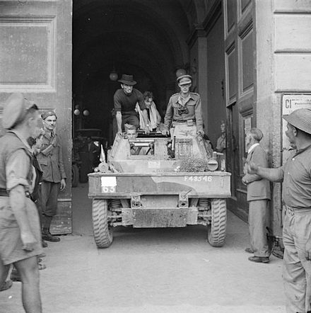Daimler scout car of the 1st King's Dragoon Guards at the town hall in Naples, 1 October 1943. The British Army in Italy 1943 NA7433.jpg
