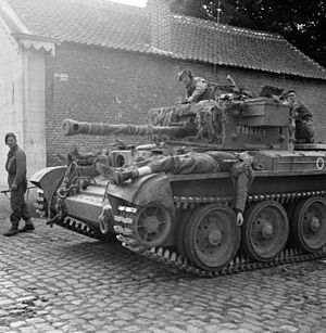 Cromwell tank - Wounded German soldiers being ferried to an aid post on the hull of a Cromwell tank