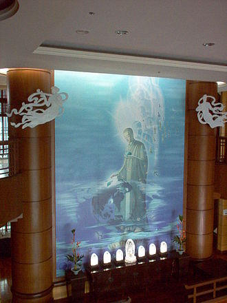 """Tzu Chi - Tzu Chi Foundation's depiction of the Buddha on a wall mural. The image is known as """"The Great Awakened of the Universe (宇宙大覺著)""""."""