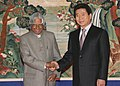 The President Dr. A.P.J. Abdul Kalam with the President of the Republic of Korea Mr. Roh Moo-Hyun on arrival at the Presidential Palace Seoul, South Korea, on February 7, 2006.jpg