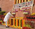 The Prime Minister, Shri Narendra Modi paying floral tributes to the martyrs of the Parliament attack, at Parliament building, in New Delhi on December 13, 2014.jpg