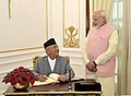 The Prime Minister of Nepal, Mr. K.P. Sharma Oli signing the visitors' book, at Hyderabad House, in New Delhi on April 07, 2018. The Prime Minister, Shri Narendra Modi is also seen.jpg