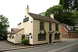 The two storey Ship Inn public house.