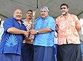 The Vice President of Commonwealth Games Federation, Oceania Region, Mr. Tapasu Ming Leung Wai hands over the Queen's Baton Delhi 2010 to the Prime Minister of Samoa, Mr. Susuga Tuilaepa Lupesoli'ai Sa'ilele Malielegaoi.jpg