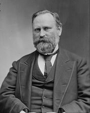 Black-and-white photograph of a bearded man