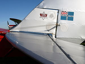 Aircraft fabric covering - Fabric covering of a de Havilland Tiger Moth showing rib stitching and inspection rings.