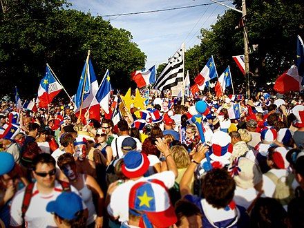 Acadians celebrating the Tintamarre and National Acadian Day in Caraquet, New Brunswick. Tintamarre during National Acadian Day 2009, Caraquet New Brunswick.jpg