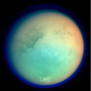"Titan in false color showing surface details and atmosphere. ""Xanadu"" is the bright region at the centre-right"