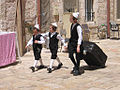 Toldos Aharon kids prepare for Shabbat, Mea Shearim, Jerusalem.jpg
