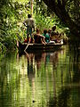 Tourists Take Boat Trip through Backwaters of Kerala - India.JPG