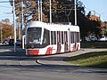 Tram 502 stopped at a Traffic Light at Peterburi tee in Tallinn 20 October 2015.jpg