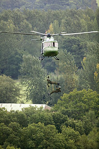 Two soldiers from the Royal Electrical and Mechanical Engineers (REME) abseil from an Army Air Corps Lynx helicopter MOD 45148285