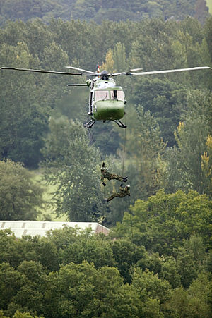 Royal Electrical and Mechanical Engineers - Two soldiers from the Royal Electrical and Mechanical Engineers (REME) abseil from an Army Air Corps Lynx helicopter.