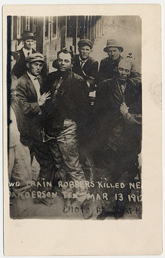 Butch Cassidy's Wild Bunch - Photograph shows the bodies of Ben Kilpatrick and Ole Hobek being held up by others after being killed near Sanderson Tex., Mar. 13, 1912