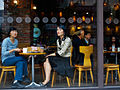 Two women seen through a caffee window during a lunch break in Busan downtown. Busan, South Korea.jpg