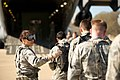 U.S. Air Force Staff Sgt. Rosemery Aragon, left, an aeromedical service superintendent with the 43rd Aeromedical Evacuation Squadron, directs Airmen as they unload simulated patients and equipment from a C-17 140313-F-RW714-259.jpg
