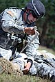 U.S. Army Pfc. Cameron Loehr, assigned to the 1st Battalion, 4th Infantry Regiment provides first aid to a simulated casualty during the Joint Multinational Readiness Center's Expert Infantry Badge Competition 130806-A-HE359-036.jpg