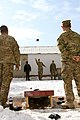 U.S. Army Staff Sgt. Brian Jones, center, a chaplain assistant with Task Force Durable, plays a game of cornhole with Maj. Mijikai Mason, corner right, and other Soldiers at Bagram Airfield in Parwan province 130119-A-FS017-119.jpg