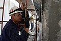 U.S. Coast Guard Chief Warrant Officer Chris Bosley, foreground, a marine inspector with Coast Guard Sector San Diego, checks a weld for watertight integrity aboard the Bay Breeze, a ferry from Alameda, in Chula 130801-G-JY570-040.jpg