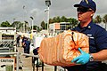U.S. Coast Guard Petty Officer 1st Class Carl Jester unloads contraband transferred from the from high-endurance cutter USCGC Gallatin (WHEC 721) during Operation Martillo in Miami June 7, 2013 130607-G-KU792-008.jpg