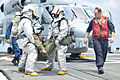 U.S. Navy Hull Maintenance Technician 1st Class Edward Buchanan, right, trains Hull Maintenance Technician Fireman Garrett Trotta and Damage Controlman 2nd Class Tavoris West during a flight deck crash 130807-N-YZ751-114.jpg