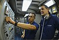 U.S. Navy Interior Communications Electrician 3rd Class Peter Rozo and Electronics Technician 3rd Class Jonathan Stremel operate a main interior communication switchboard aboard the guided missile cruiser USS 130513-N-QL471-110.jpg