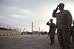 U.S. Navy Petty Officer 2nd Class Dennis VanZuiden, right, salutes a U.S. flag during a ceremony at the Naval Mobile Construction Battalion 15 battalion aid station at Camp Leatherneck, Afghanistan, June 28 130628-M-TM093-019.jpg