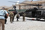 U.S. Sen. Bob Corker of Tennessee, second from right, prepares to board a U.S. Army UH-60 Black Hawk helicopter July 7, 2013, at Camp Integrity, Afghanistan 130707-N-QV903-033.jpg