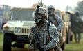 U.S. Soldiers with Headquarters and Headquarters Company, 2nd Battalion, 502nd Infantry Regiment, 2nd Brigade Combat Team, 101st Airborne Division (Air Assault) wear M-40 gas masks during a recovery scenario 090910-A-PY395-004.jpg