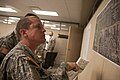 U.S. Soldiers with the 45th Infantry Brigade Combat Team, Oklahoma Army National Guard, review maps of Moore, Okla., to plan the location of entry control points to neighborhoods May 21, 2013, in Moore 130521-Z-RH707-079.jpg