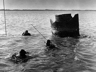 USS Harvest Moon (1863) - SCUBA Divers use rods to probe the area of the Harvest Moon's wreck, circa 1963. Note the remains of her smokestack nearby.