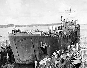 USS LST-476 in a floating drydock, circa 1945, location unknown. Note the movie screen on the starboard side of the main deck.