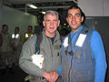 US Navy 030314-N-4964S-002 U.S. Marine Lt. Col. (retired) Oliver North takes the time to pose for a photograph with Airman Teddy Mirzaian in the triage room off the flight deck aboard the amphibious assault ship USS Tarawa.jpg
