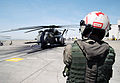 US Navy 030506-N-0020T-004 Aviation Structural Mechanic 1st Class James Hale prepares for engine start on an MH-53E Sea Dragon helicopter at Naval Air Station (NAS) Sigonella.jpg