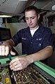 US Navy 030702-N-1577S-001 Aviation Electronics Technician Airman Jeremy Butler tightens screws on a radar transmitter for an F-A-18 Hornet aboard USS Nimitz (CVN 68).jpg