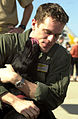 US Navy 031104-N-6213R-018 Lt. Rich Daniels receives kisses from his dog for the first time in eight months.jpg