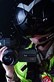 US Navy 040325-N-9885M-016 Photographer's Mate 2nd Class Joseph Tepas assigned to Combat Camera Group Pacific, uses a PDX-10 digital camera to film events of a Multilateral Undersea Warfare (USW) exercise.jpg