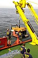 US Navy 040426-N-7949W-007 Deep Submergence Unit (DSU) Unmanned Vehicle Detachment (UMA Det) personnel guide the Super Scorpio remote operated vehicle (ROV) to a safe recovery.jpg