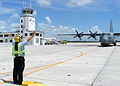 US Navy 040910-N-4779D-068 Aviation Boatswain's Mate 2nd Class James Appleby directs the arrival of a National Air Guard C-130 from N.C.jpg