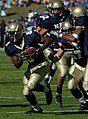 US Navy 041023-N-9693M-003 U.S. Naval Academy slotback Jeremy McGown rushes for yardage in the first quarter against the Rice Owls.jpg