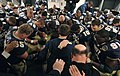 US Navy 041204-N-2383B-462 Midshipmen offer a prayer following a victorious 105th Army Navy game.jpg