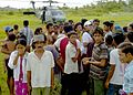 US Navy 050103-N-6020P-190 Stranded Indonesian citizens gather near a landing site for an SH-60F Seahawk helicopter.jpg