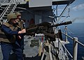 US Navy 050504-N-5526M-002 Quartermaster Seaman Jeffery Hammond fires a MK-79 Grenade Launcher as Fire Controlman 3rd Class Albert Roddy checks for accuracy during a Pre-Aim Calibration Fire (PACFIRE) exercise.jpg