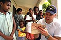 US Navy 050517-N-1485H-006 Ensign Matt Nolan assigned to the Military Sealift Command (MSC) hospital ship USNS Mercy (T-AH 19) documents a local child's medical record in the village of Madang.jpg