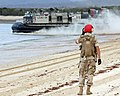US Navy 050619-N-3455P-002 A beachmaster watches as a Landing Craft, Air Cushion (LCAC) vehicle take off after dropping off Australian Army Soldiers at Sabina Point during exercise Talisman Saber 2005.jpg