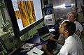US Navy 050910-N-7676W-063 Aamir Qaiyumi, foreground, and Mark Connelly, with Naval Sea Systems Command (NAVSEA) in Panama City, Fla., analyze data from Remote Environmental Monitoring Units (REMUS) aboard the Office of Naval R.jpg